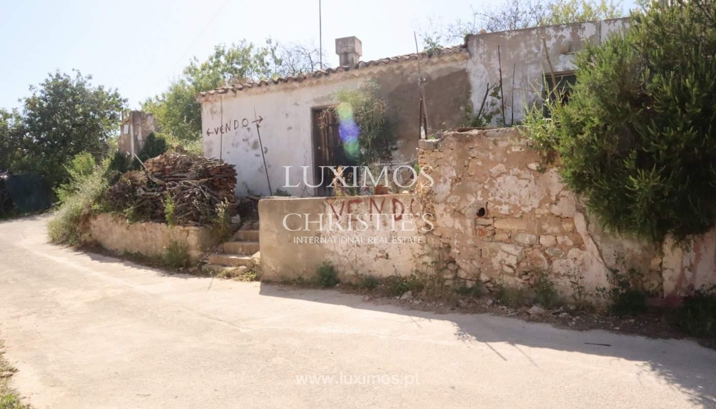 Land, zu verkaufen, mit Ruine zum Wiederaufbau und Meerblick, Loulé_143369